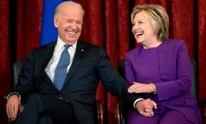 Biden and Hillary Clinton laugh during a portrait presentation on Capitol Hill in December 2016.