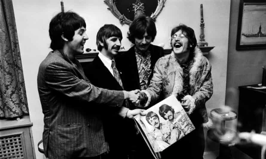 The Beatles hold the sleeve of their new LP, 'Sgt. Pepper's Lonely Hearts Club Band', at the press launch for the album, held at Brian Epstein's house at 24 Chapel Street, London, 19th May 1967.