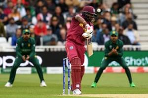 West Indies' Darren Bravo prods Pakistan's Mohammad Amir delivery to Babar Azam's waiting hands.