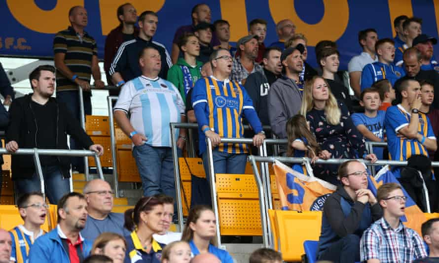 Shrewsbury Town supporters watch a game from the safe standing area at the club's ground.