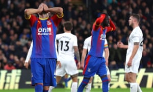 Crystal Palace's Luka Milivojevic (left) after missing a chance during win over Burnley – one of only three victories this season.