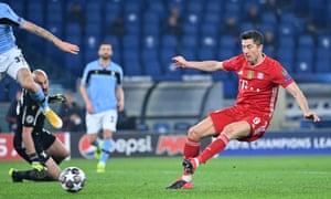 Bayern Munich's Polish forward Robert Lewandowski shoots to open the scoring.