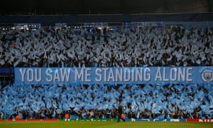 The Manchester City fans cheer on their side ahead of kick-off.