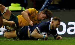 Byron McGuigan scores his second try, Scotland's sixth, in their 53-24 win against Australia at Murrayfield