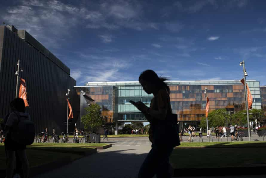 A student walks past buildings at the University of Sydney