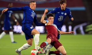 West Ham's Declan Rice slides to try to dispossess Chelsea's Ross Barkley at the London Stadium on 1 July.