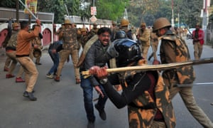 Police officers confront protesters in Lucknow on 19December.
