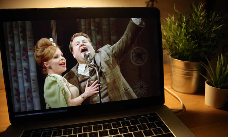 National Theatre Live online stream of One Man, Two Guvnors shown on a laptop