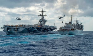 The US aircraft carrier Abraham Lincoln is refuelled. It as moved to the Middle East from the Mediterranean last month.