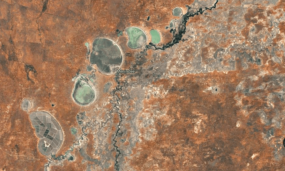 A satellite image shows land under cultivation at Tandou, in a dry lake at the lower left. Above it are the Menindee Lakes.