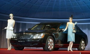 Models pose next to German carmaker Mercedes-Benz's Maybach 62, during a 2004 unveiling at a hotel in Seoul.