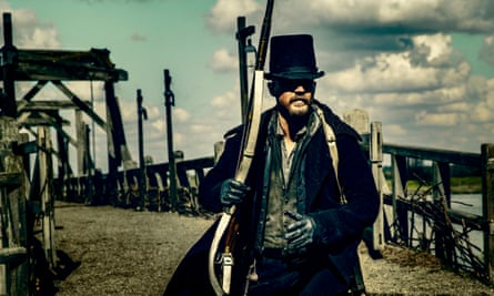 Tom Hardy's James Delaney holding a musket in Taboo