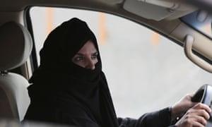 A woman drives in Saudi Arabia