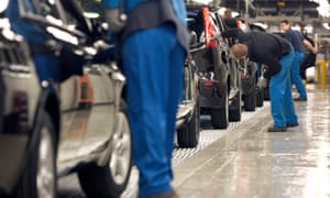 Assembly line workers in a car factory