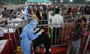 A health worker takes a nasal swab at a Covid-19 facility in Ahmedabad.
