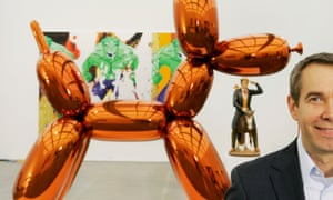 'I don't labour over each piece – but I oversee them tremendously' … Jeff Koons with a Balloon Dog sculpture.