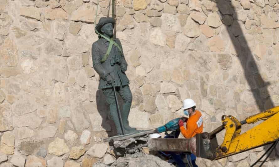 A worker removes a statue of former Spanish dictator Francisco Franco in Melilla, north Africa.