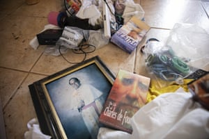 A photo of former Archbishop Anthony Apuron lays among discarded items on the floor of the former Accion Hotel