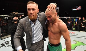Conor McGregor celebrates with Artem Lobov of Russia after his featherweight bout against Teruto Ishihara during the UFC Fight Night in Belfast in November.