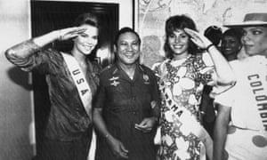 Miss USA, Christy Fichtner, left, and Miss Panama, Gilda García López, salute while flanking Gen Manuel Antonio Noriega in Panama City.
