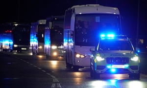 Evacuees arrive in coaches to Arrowe Park Hospital