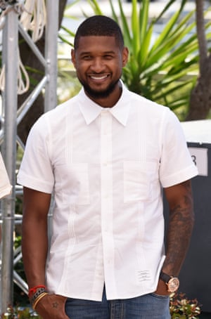 Usher is buttoned up at the Hands of Stone premiere