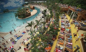 Visitors relax at the beach in the indoor Tropical Islands theme park, Krausnick, Germany