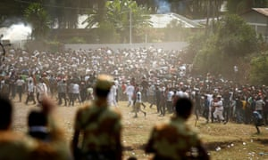 Protesters run from teargas during the Irreecha festival of thanksgiving in Bishoftu.