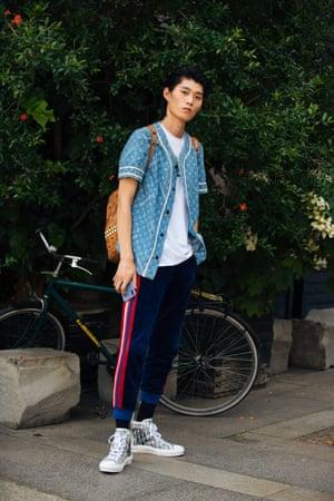 A model at Milan's Men's fashion week in 2019, wearing a Louis Vuitton Supreme baseball shirt