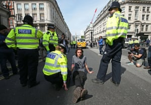 A demonstrator is arrested at Oxford Circus.