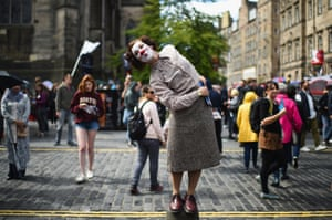 Edinburgh Festival Fringe entertainers perform on the Royal Mile. This year marks the 70th anniversary of the largest performing arts festival in the world