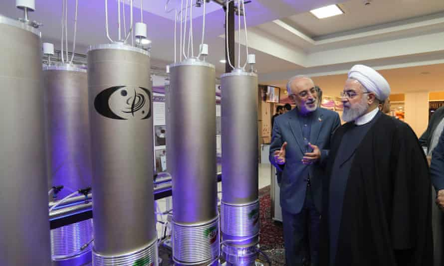 The Iranian president, Hassan Rouhani (right), and the head of Iran's Atomic Energy Organisation, Ali Akbar Salehi, inspecting nuclear technology in April 2019.