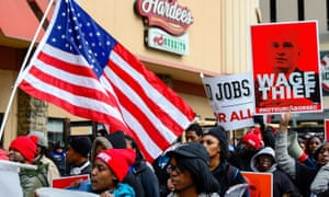 Protesters rally against labor nominee Andrew Puzder outside of a Hardee's restaurant on 13 February.