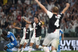 Napoli's Kalidou Koulibaly (left) reacts after shinning the ball into his own net whilst Juventus' Cristiano Ronaldo and teammates celebrate an unlikely winner.