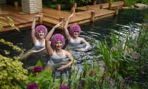 Members of the Aquabatix synchronised swimming group perform in the M&G garden at the Chelsea flower show.