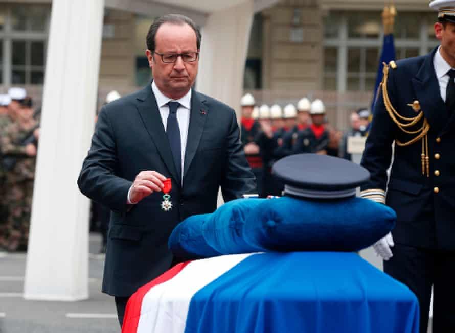 French president François Hollande presents a posthumous award to Xavier Jugelé.