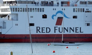 A Red Funnel ferry near the semi-submerged mast of a yacht that sank after the collision at East Cowes, Isle of Wight.