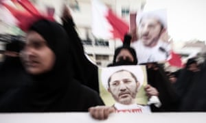 Protesters in Manama carry photographs of Sheikh Ali Salman
