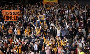 Tigers supporters cheer after a try is awarded during the round 23 NRL match between the Wests Tigers and the Manly Sea Eagles at Leichhardt Oval on 13 August 2017.