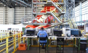 A Qantas plane in a maintenance hanger in Brisbane. The firm is to buy eight Boeing Dreamliners after turning around its performance.