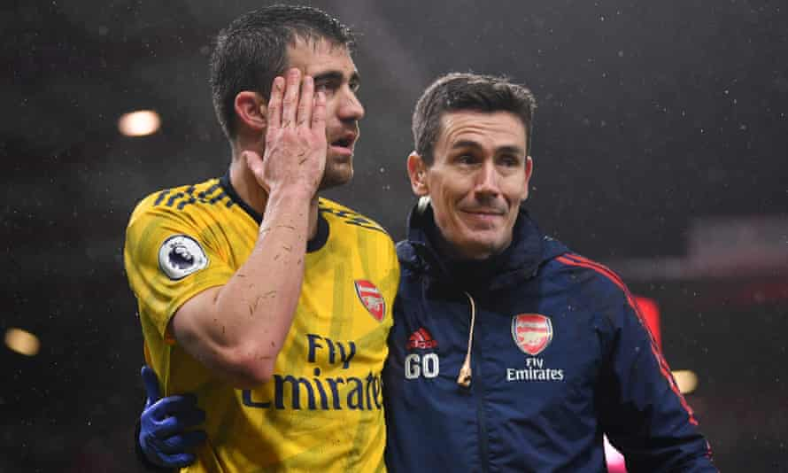 Dr Gary O'Driscoll helps Arsenal's Sokratis Papastathopoulos off the pitch earlier this season.