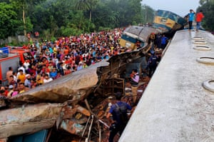 Dhaka, Bangladesh. People gather at the accident site in the district of Brahmanbaria where a head-on collision between two trains killed 16 people early in the week