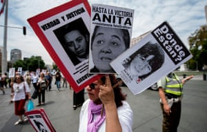 Relatives of people who disappeared during the military dictatorship demand Sebastian Piñera's government to speed up the search for victims, during a demonstration in front of the La Moneda presidential palace in Santiago