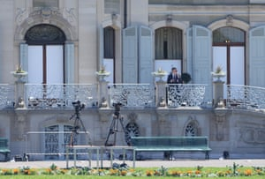 A security guard stands outside the villa