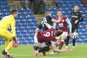 West Ham United midfielder Tomás Soucek (28) brings down Burnley forward Chris Wood (9) for a penalty.