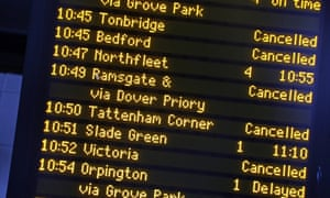 A railway passenger board signals delays and cancellations to train services