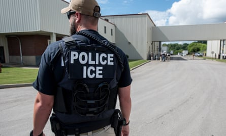 US Immigration and Customs Enforcement (Ice) special agent preparing to arrest immigrants at Fresh Mark, in Salem, on 19 June.