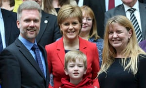 Gregg (L) Kathryn (R) and Lachlan Brain pose for photographers with Scotland's First Minister Nicola Sturgeon