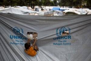 A child plays on plastic sheeting at Ritsona refugee camp, north of Athens