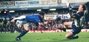 Coventry keeper Steve Ogrizovic saves a header from Everton's Nick Barmby.